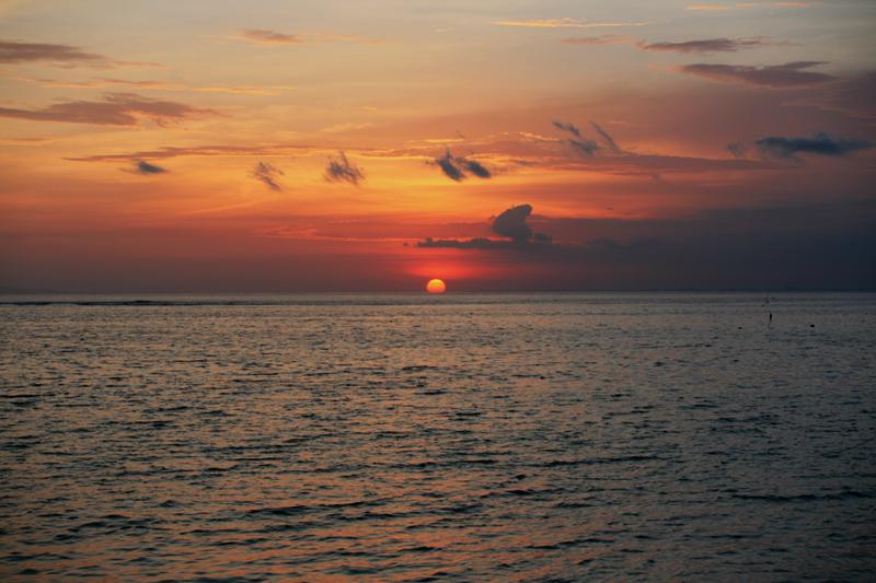 Solnedgang, høyvann